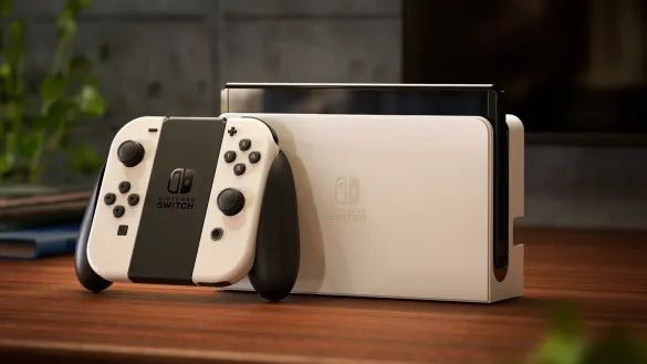 The Nintendo Switch OLED in white on a table