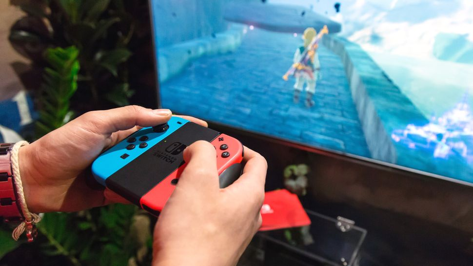 Someone playing The Legend of Zelda: Breath of the Wild on a Nintendo Switch