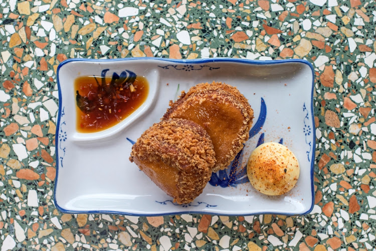 A delicious portion of prawn toast from Bao Down. Picture: ADRIAN SHIELDS