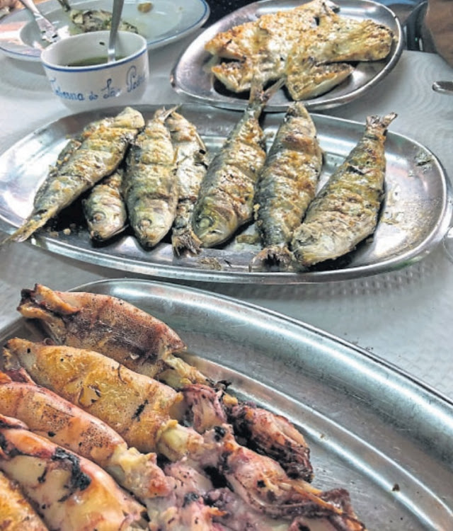 Mouth-watering: Fish fresh from the ocean fried on the street for customers at the Taberna do Sao Pedro in Porto, Portugal. Picture: ALEXANDER MATTHEWS