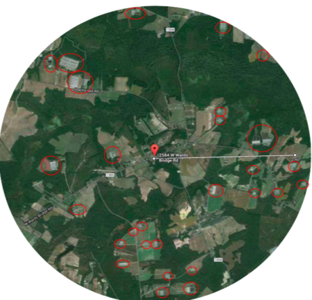 shows an arial photograph of a farm area, some red circles around some locations visible on the map.