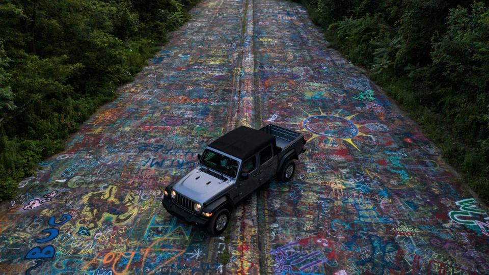 A Jeep Gladiator sits on the Graffiti Highway in Centralia, Pennsylvania--an abandoned strip of highway that's been converted over the years to public art.