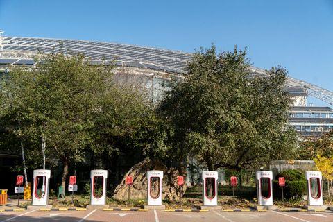 A Tesla charging station on a hotel parking lot.  After...