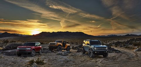 pre production versions of the all new 2021 bronco family of all 4x4 rugged suvs, shown here, include bronco sport in rapid red metallic tinted clearcoat, bronco two door in cyber orange metallic tri coat and bronco four door in cactus gray