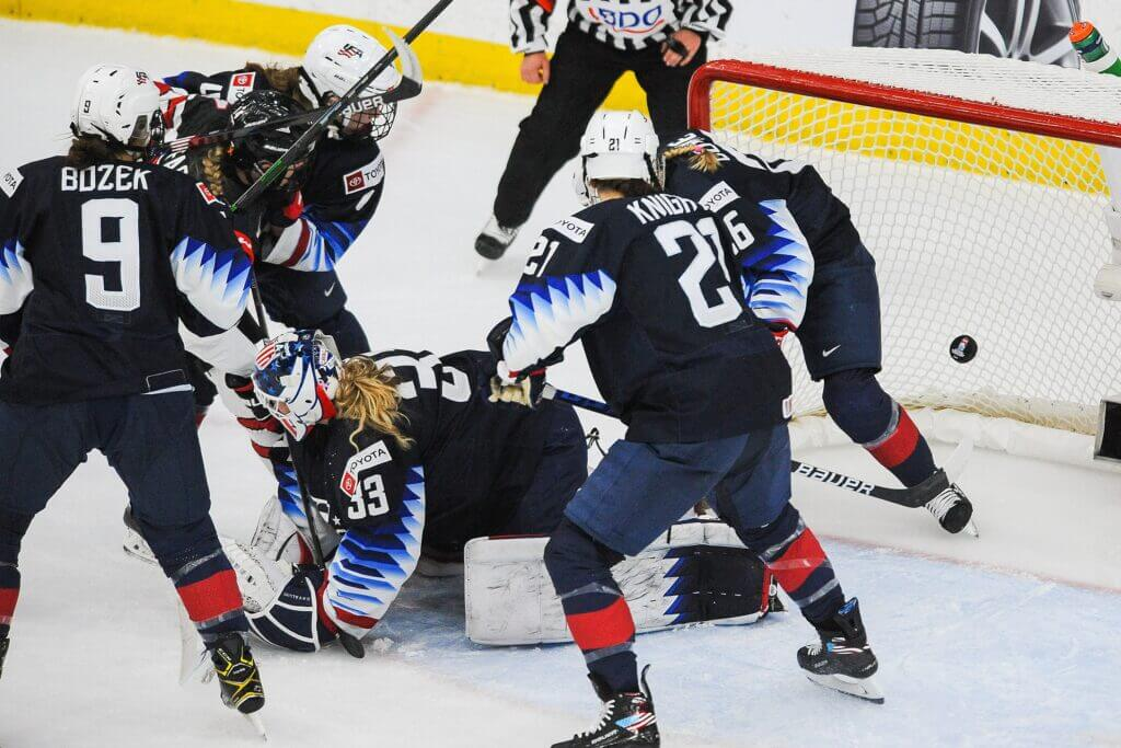 CALGARY, AB - AUGUST 26: Renata Fast #14 of Canada scores on the net of Alex Cavallini #33 of United States in the 2021 IIHF Women's World Championship Group A match played at WinSport Arena on August 26, 2021 in Calgary, Canada. (Photo by Derek Leung/Getty Images)