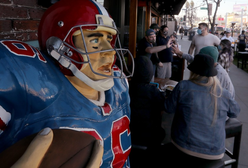 Football fans gather at Legends Restaurant & Sports Bar in Long Beach on Sunday to watch the Super Bowl telecast.