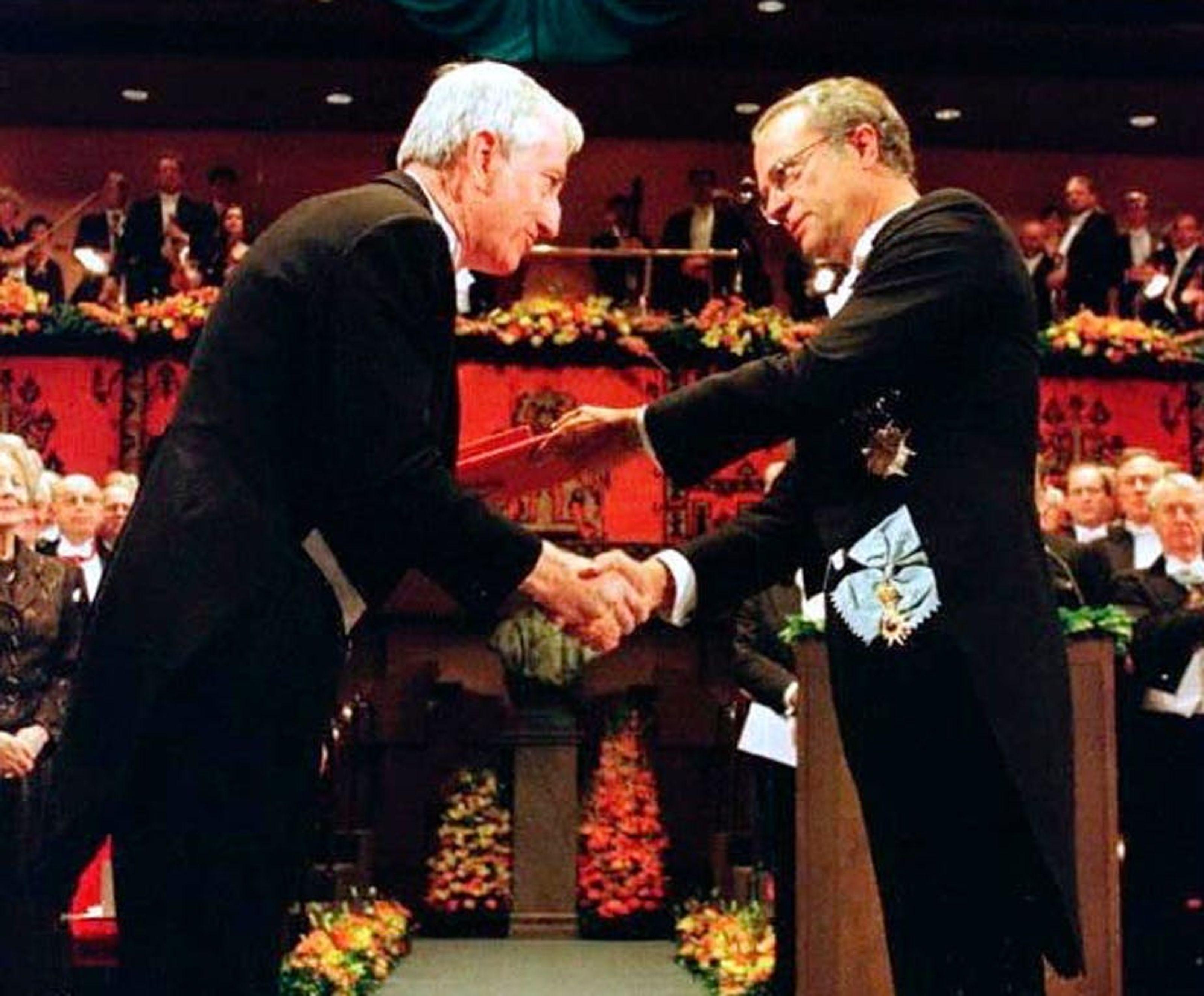 Peter Doherty picks up his Nobel Prize for Medicine fromSweden's King Carl Gustav